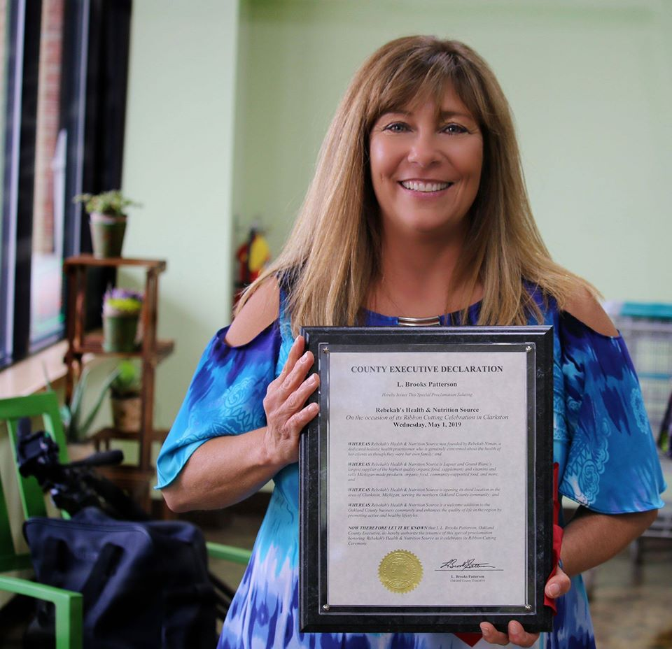 Rebekah-Niman-holding-county-executive-declaration-certificate